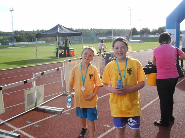 Connie & Jonjoe finish and receive their medal and refreshments