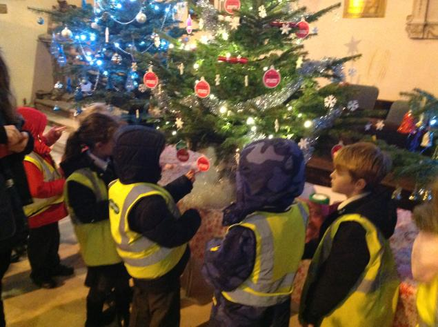 Year 2 visited the Christmas Tree Festival at Otley Parish Church and sang carols.