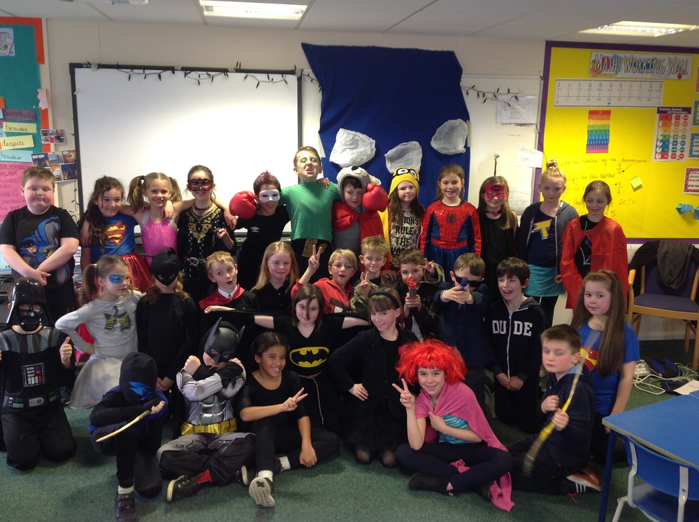 Here we are dressed as superheroes for our topic week dress up day