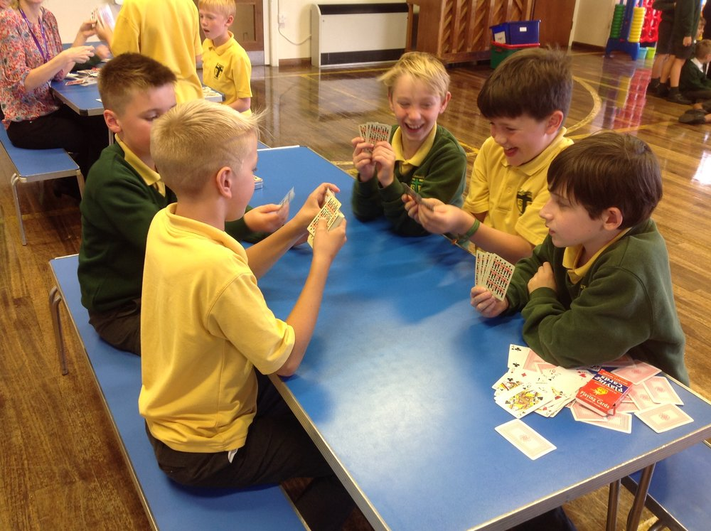 The boys are enjoying a few card games that Mrs Harvey had taught us.