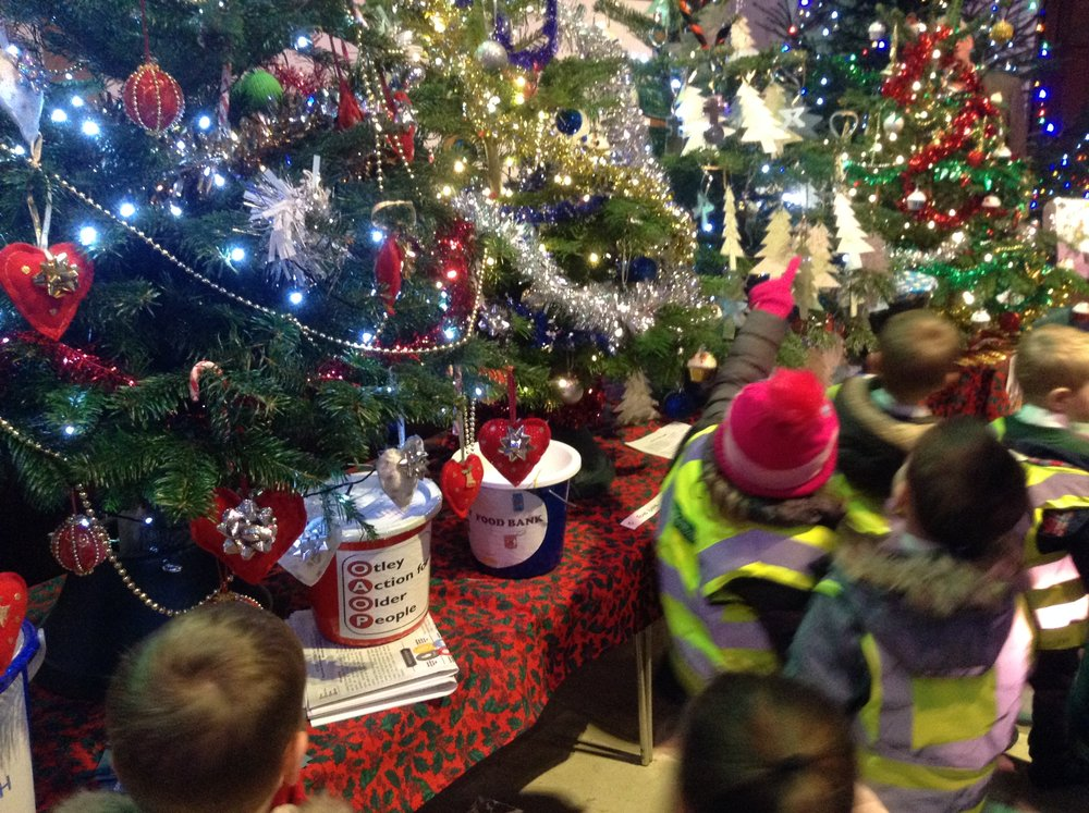 Looking at the beautifully decorated Christmas Trees. Each one decorated for a different charity.
