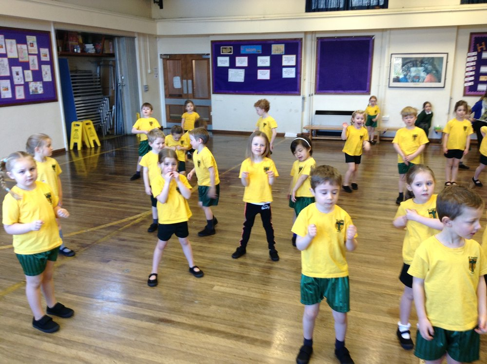 Pretending to get into our rocket in PE.