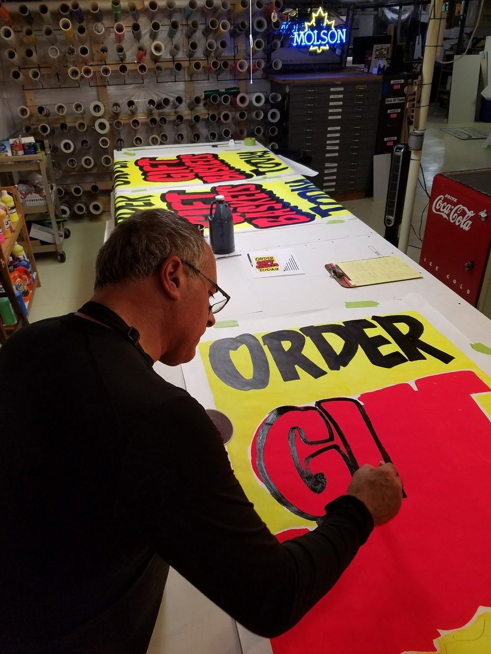 I view my graphics as a solution to my customer's problems. I help them choose the right graphic for their problem and budget. Whether it's hand lettering, cut intermediate or high performance vinyls or printed large format vinyls, banners or perforated window graphics. Substrates vary from Old School MDO Plywood and paper to the newer poly-metals, PVC and HDU Foams.