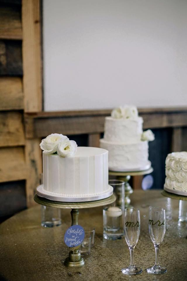 white buttercream striped wedding cake