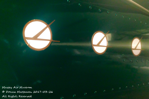Graphics on a Cessna 17Z, bisected by a lightbeam