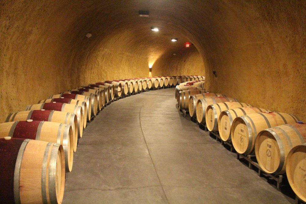 napa-valley-wine-cave-filled-with-barrels