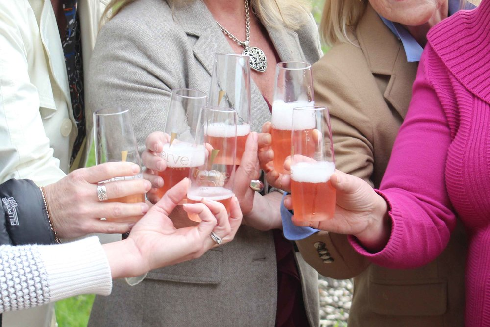 toasting-champagne-at-corporate-team-building-event-in-napa