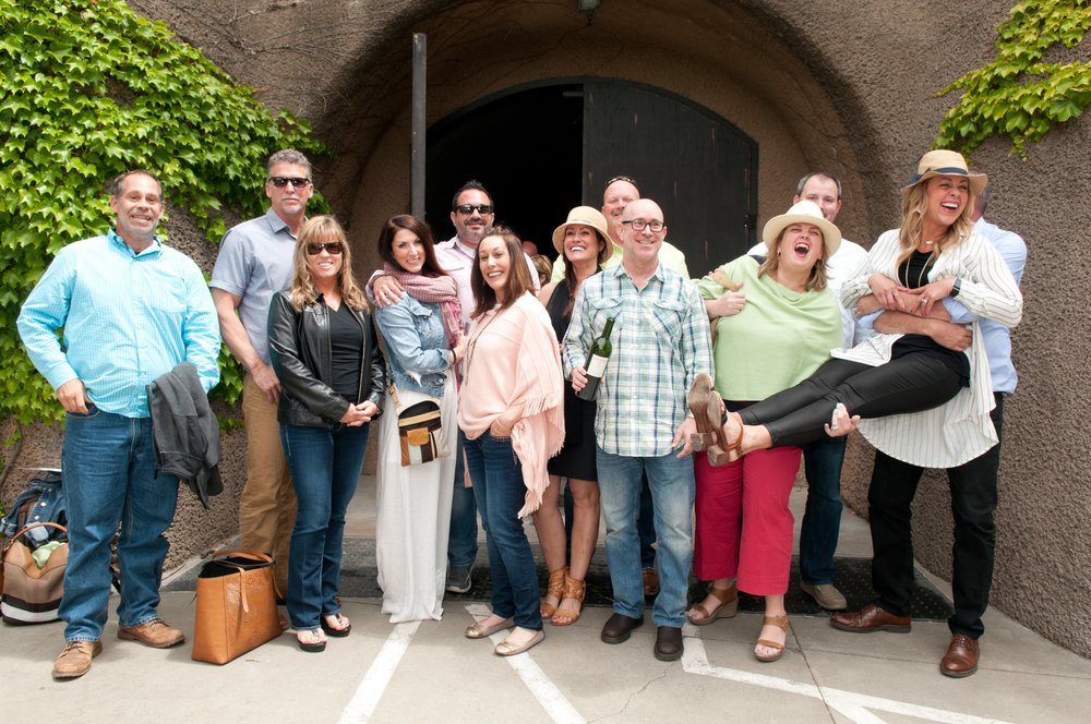 happy-wine-tour-group-in-front-of-napa-winery