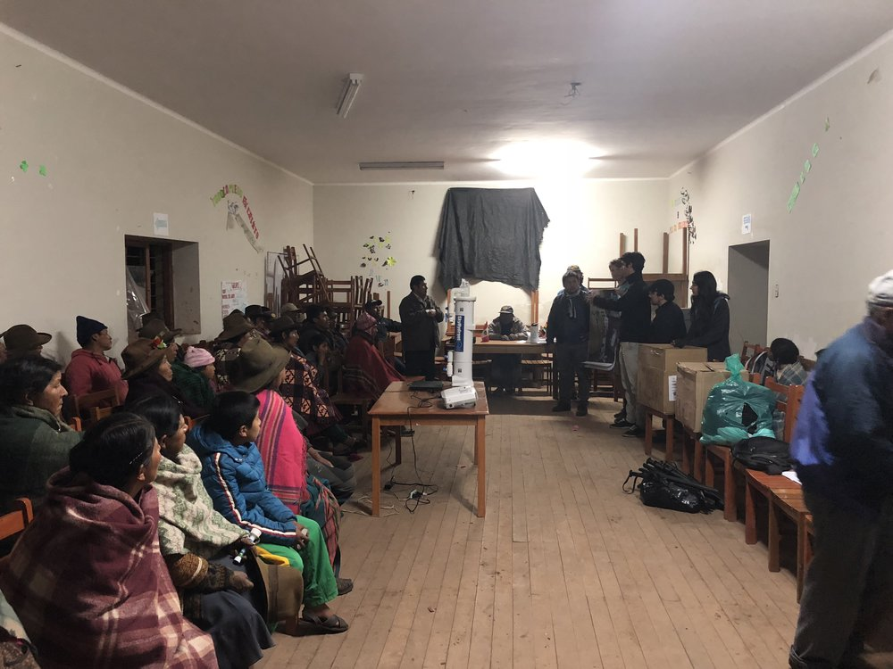 Holding a community meeting to plan the project