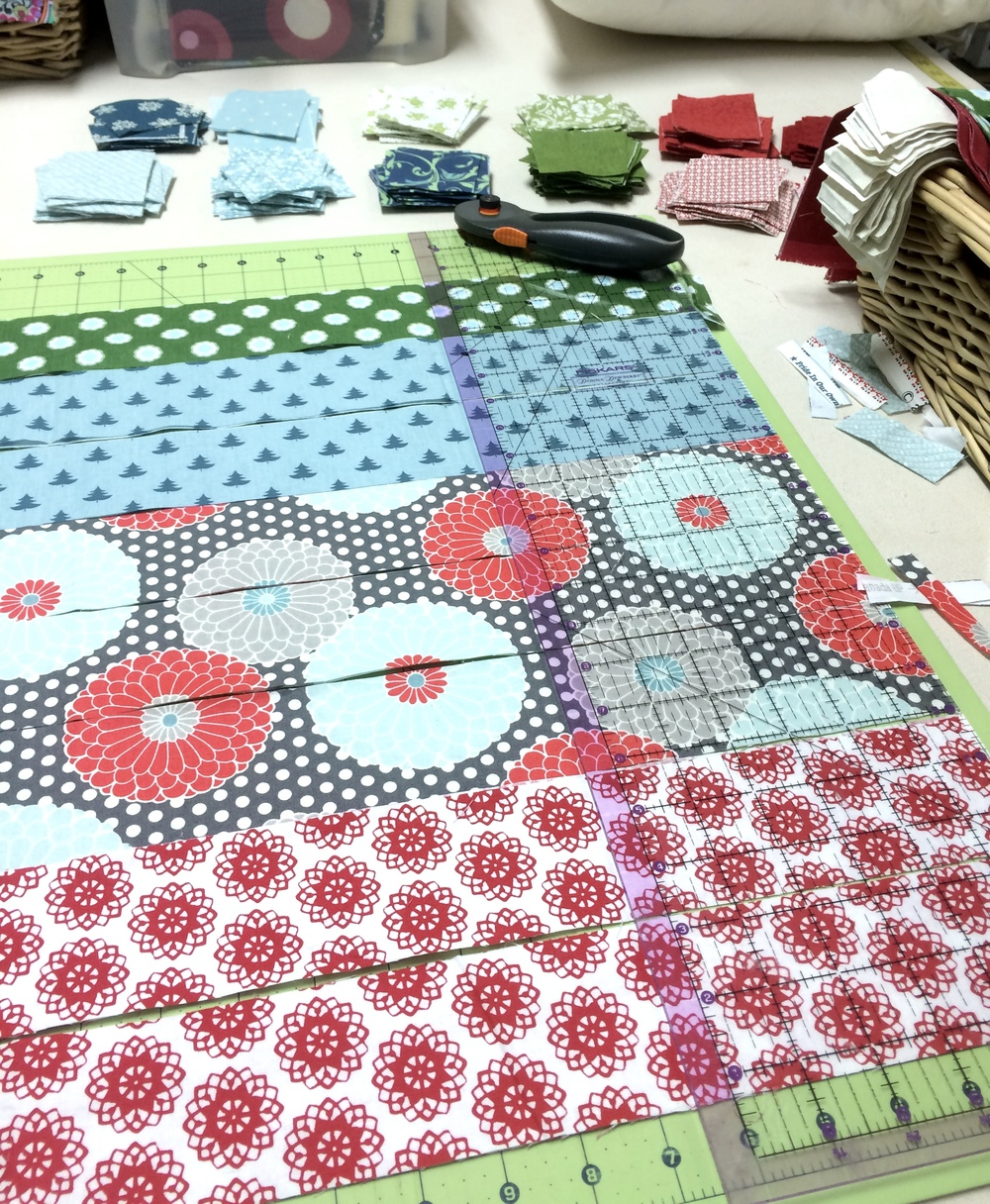 cut strips of fabric with rotary cutter