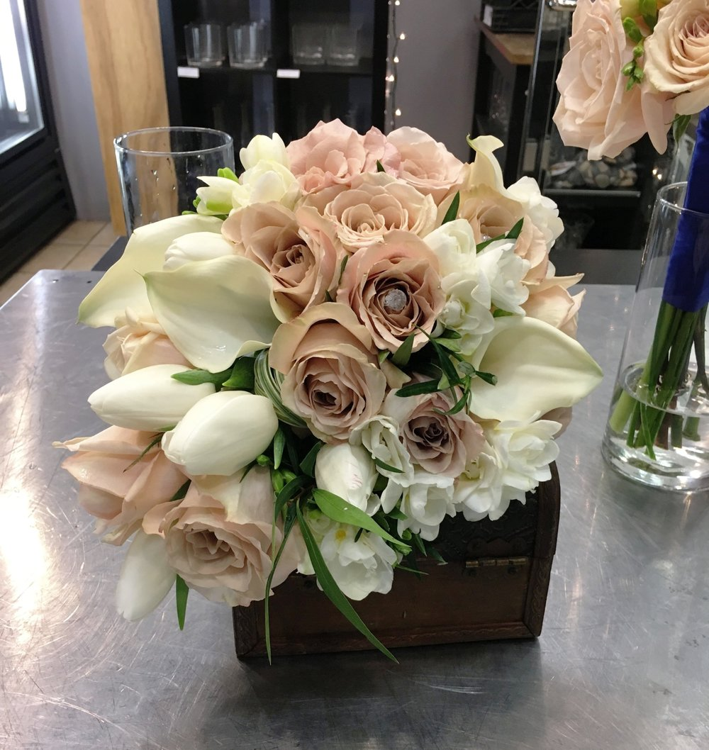 White & Sand -  1 Bride bouquet $99.99 plus taxes.  With roses, callas, tulips (seasonal) freesias and double satin ribbon color to match.