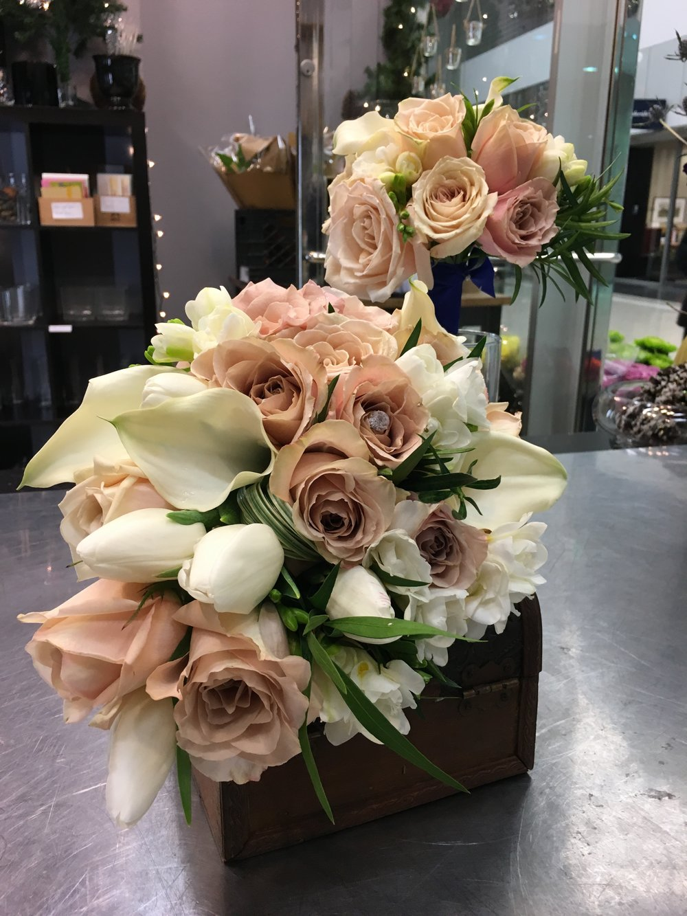 1 Bride  1 Bridesmaid bouquet $154.98 plus tax. Roses, tulips (seasonal) freesias, callas greenery and double satin ribbon