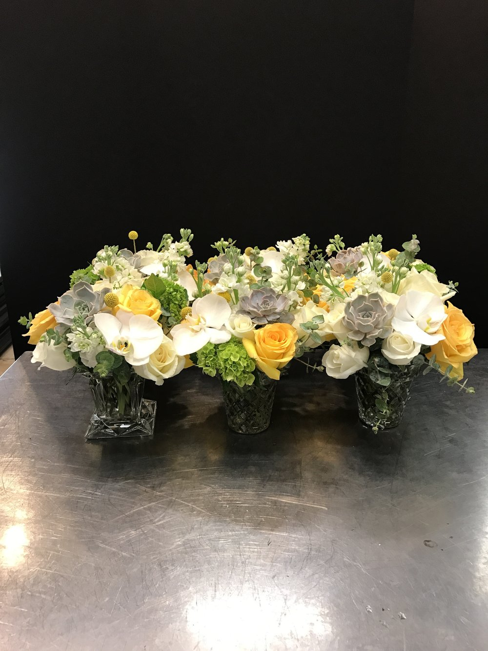 White, Yellow, gray and  Green. Set of 9 centerpieces Total Package $629.99 plus taxes. Medium size arrangement.
