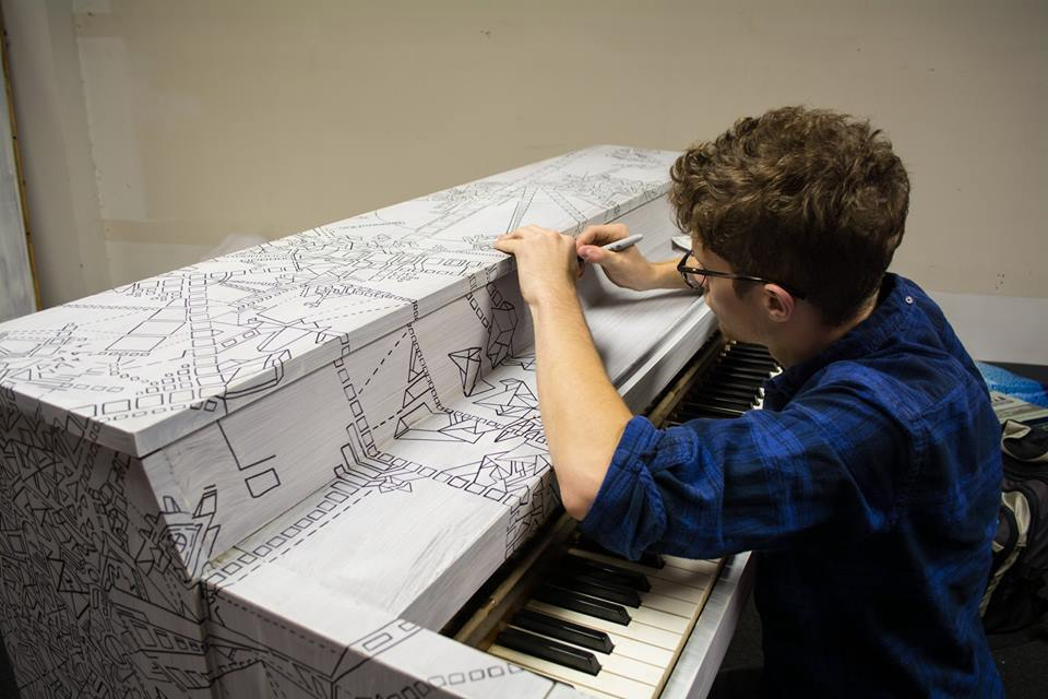 dillon on painted piano.jpg