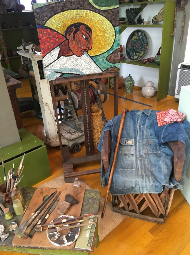 Diego Rivera's personal items in his studio and one of his pieces
