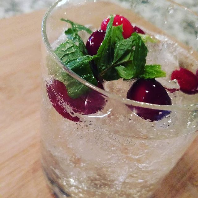 NYE Cocktail...St. Germain, champagne, fresh mint and cranberries #timeless #nyecocktails