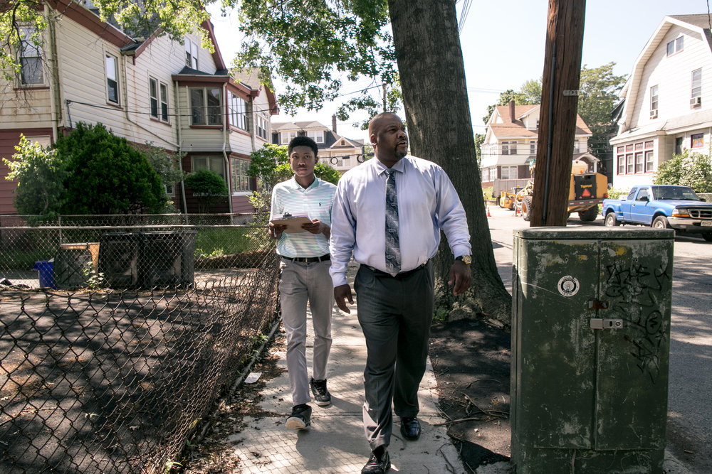 CES Deputy Director Ebin Draper field trains Newark Success Mentor Jaleel McCauley on how to conduct home visits