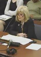 Brown testifying in committee.