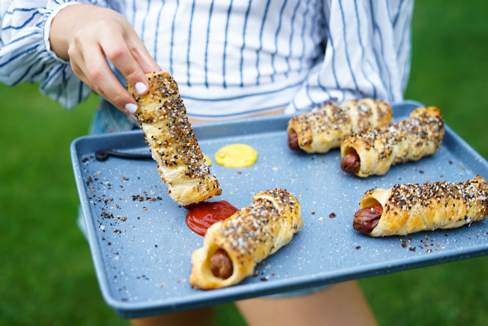Yes, I am the person who goes out of their way to become best friends with the man holding the tray of pigs in a blanket at a party. I am the girl who gets PISSED when there isn't any ketchup and only mustard (more stories about my passion for ketchup to come).   While I love the concept of little weenies as appetizers, I usually eat the equivalent of a full-sized hot dog. So, I decided it would be a great idea to turn my favorite cocktail-sized treat into one for adults (which means a large version, lol).