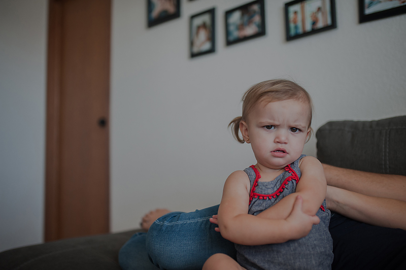 Baby girl pouting and folding arms