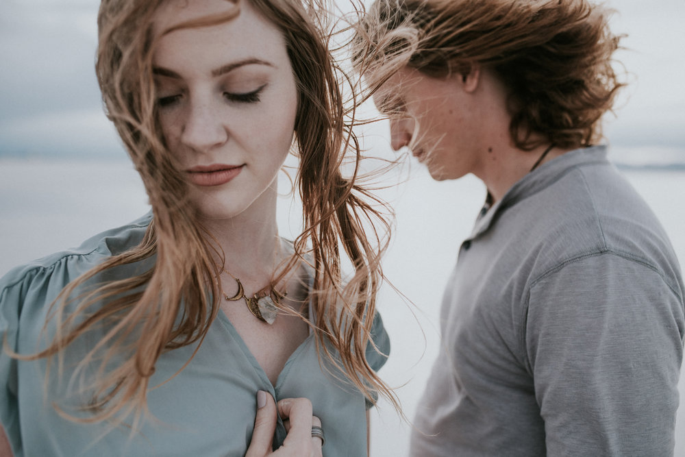 Couple at the salt flats wind blowing through their hair