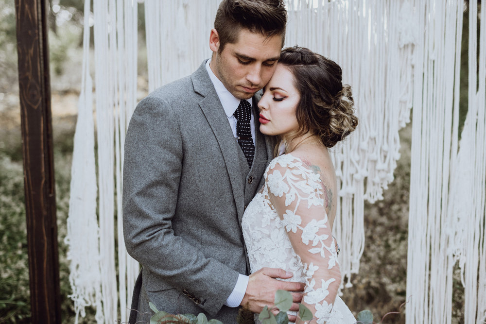 Bride and groom in front of boho Macrame at their Saratoga Springs Wedding
