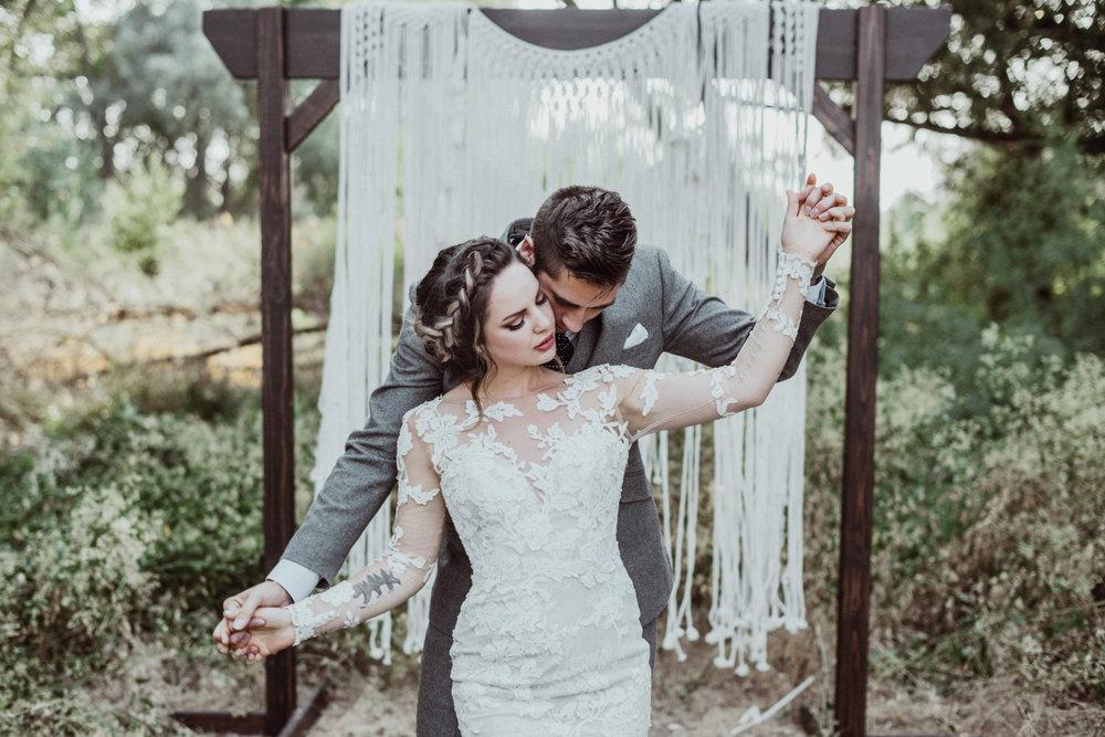 bride and groom at their Saratoga Springs wedding boho macrame