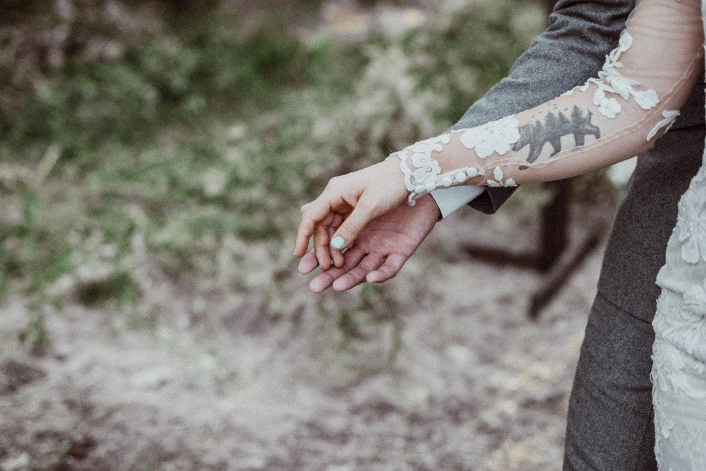 Lace wedding dress bear tattoo on forearm