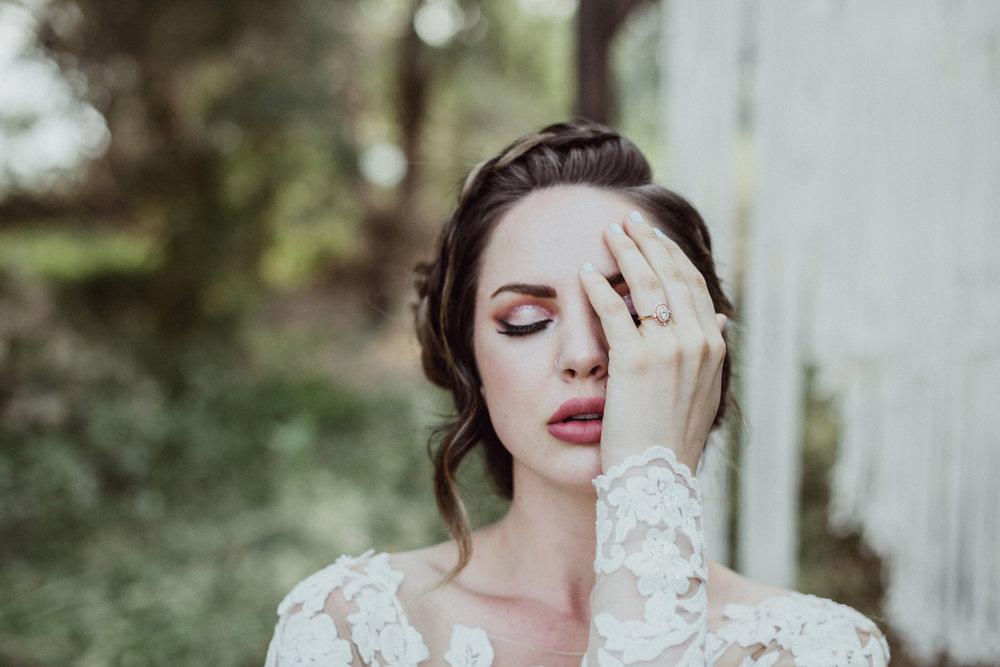 Bridal braid rose gold ring wearing lace wedding dress