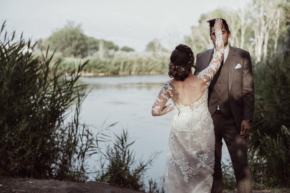 Bride fixing groom hair at loch lomond pond