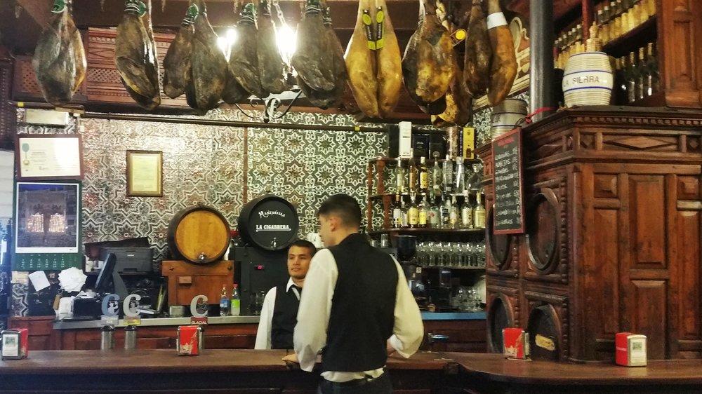 soi 55 travel top 5 tapas bars seville el rinconcillo waiters