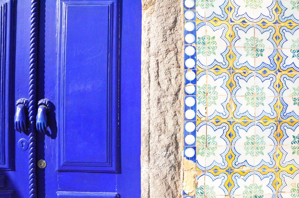 Portuguese tiles and blue door with Fatima's hands knockers | A  day in Tavira  | Algarve, Portugal | Soi 55 Travels