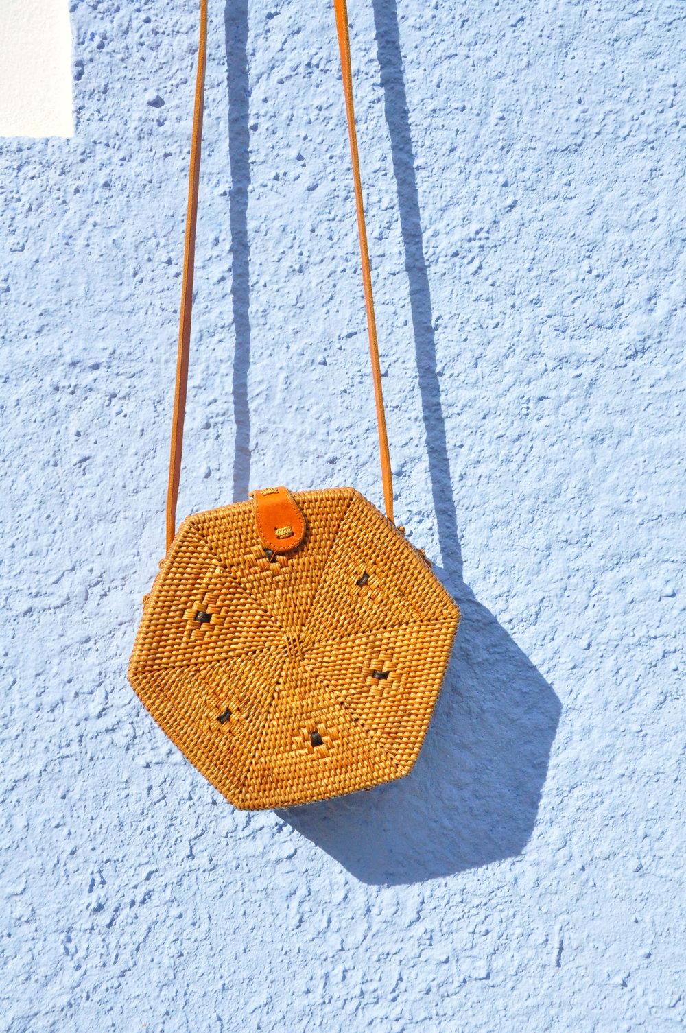 Rattan hexagon bag against blue wall    A  day in Tavira    Algarve, Portugal   Soi 55 Travels