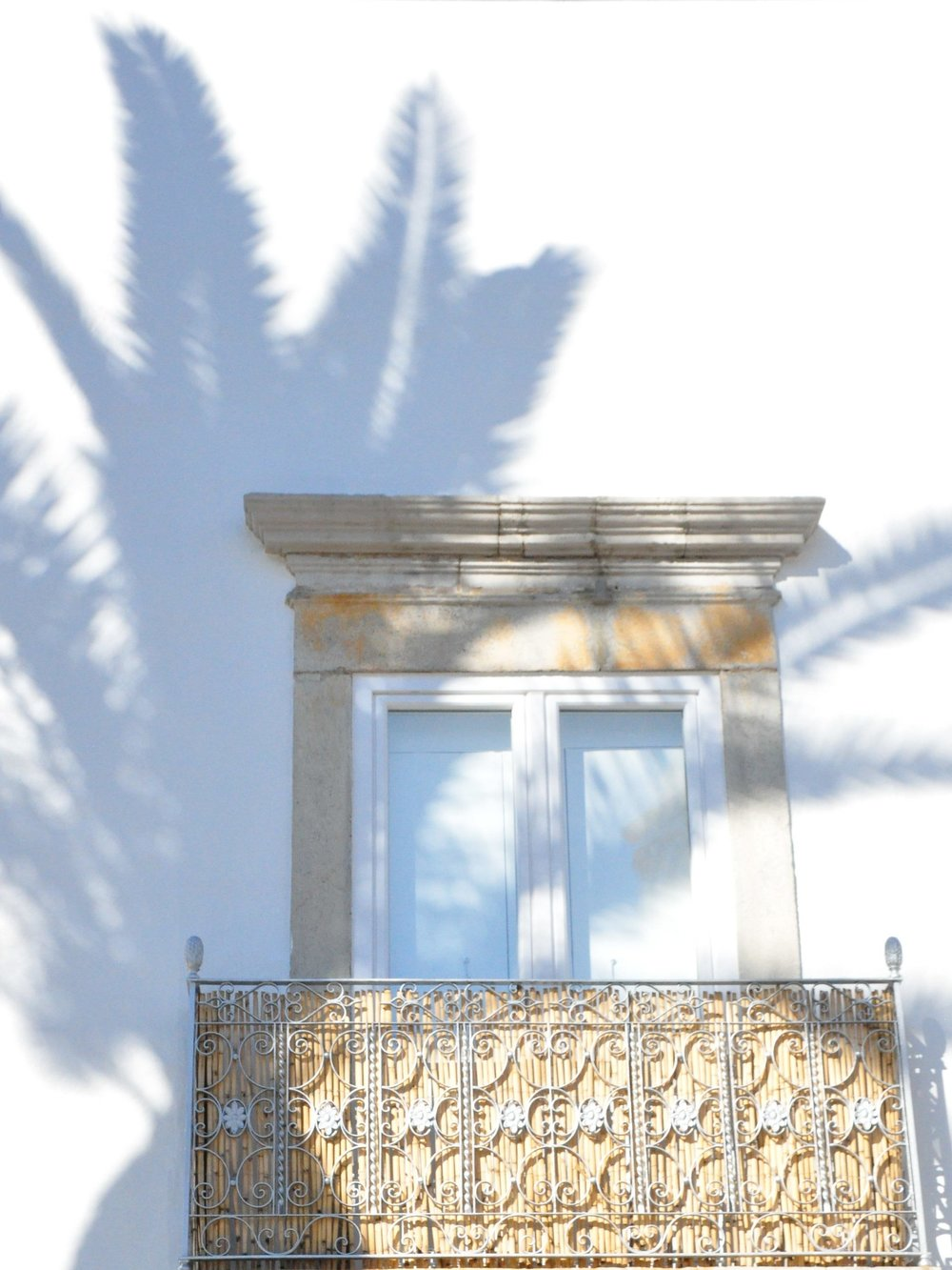Palm fringed shadows on balcony | A  day in Tavira  | Algarve, Portugal | Soi 55 Travels