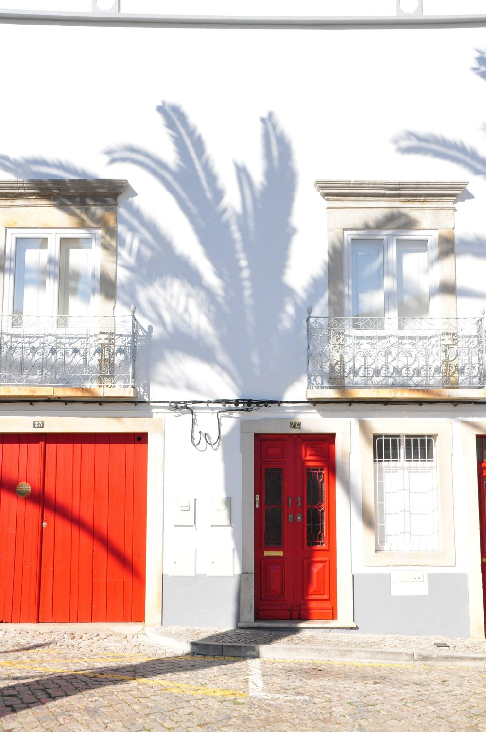 Palm fringed shadows and red doors | A  day in Tavira  | Algarve, Portugal | Soi 55 Travels