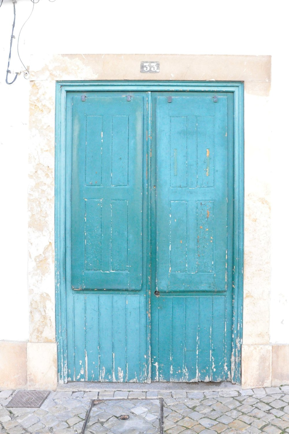Teal green door in Tavira | A  day in Tavira  | Algarve, Portugal | Soi 55 Travels