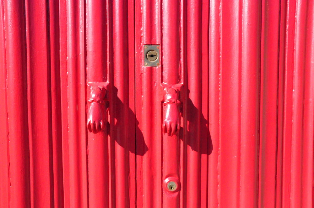 Red door with Fatima's hands knockers  | A  day in Tavira  | Algarve, Portugal | Soi 55 Travels
