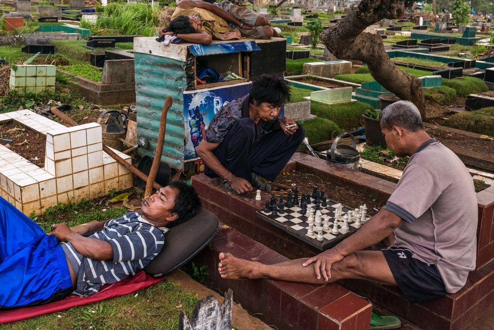 Chess game. Karet Bivat cemetery. Jakarta, Indonesia