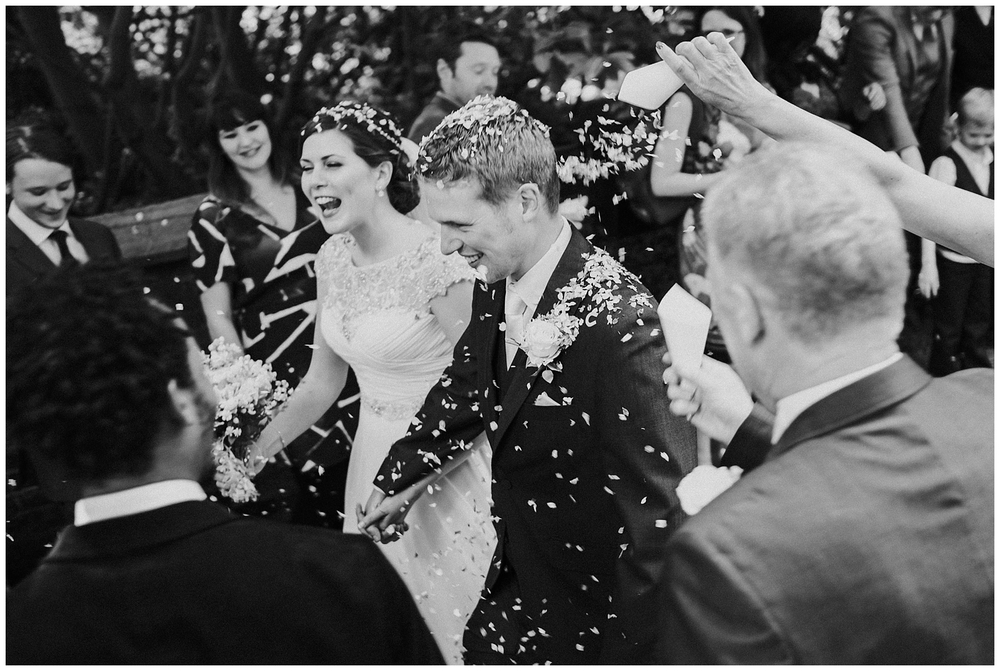 Documentary-wedding-photography-st-oswalds-church-brereton-cheshire-confetti-shot