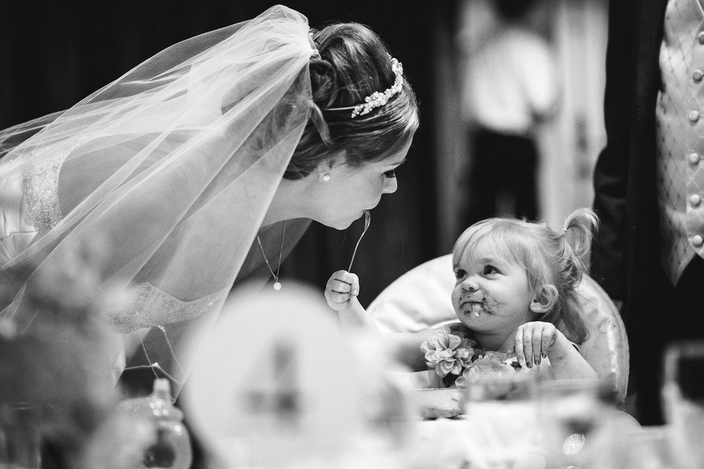 Leanne was walking round the tables during the wedding breakfast chatting to her guests when I saw this moment about to happen.  I absolutely love the eye contact in this picture.  And the chocolatey face of course!  I often convert big moments in pictures into black and white.