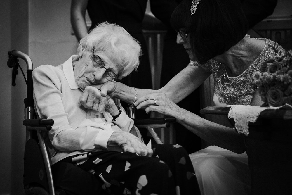 When I took this picture it actually made me cry in the church. Bride Michele holding her 91 year old mum's hand at her wedding in Macclesfield in 2016. I can't even put into words what this picture would mean to me if it were myself and my mum. Moments like this are what I am looking for at weddings.