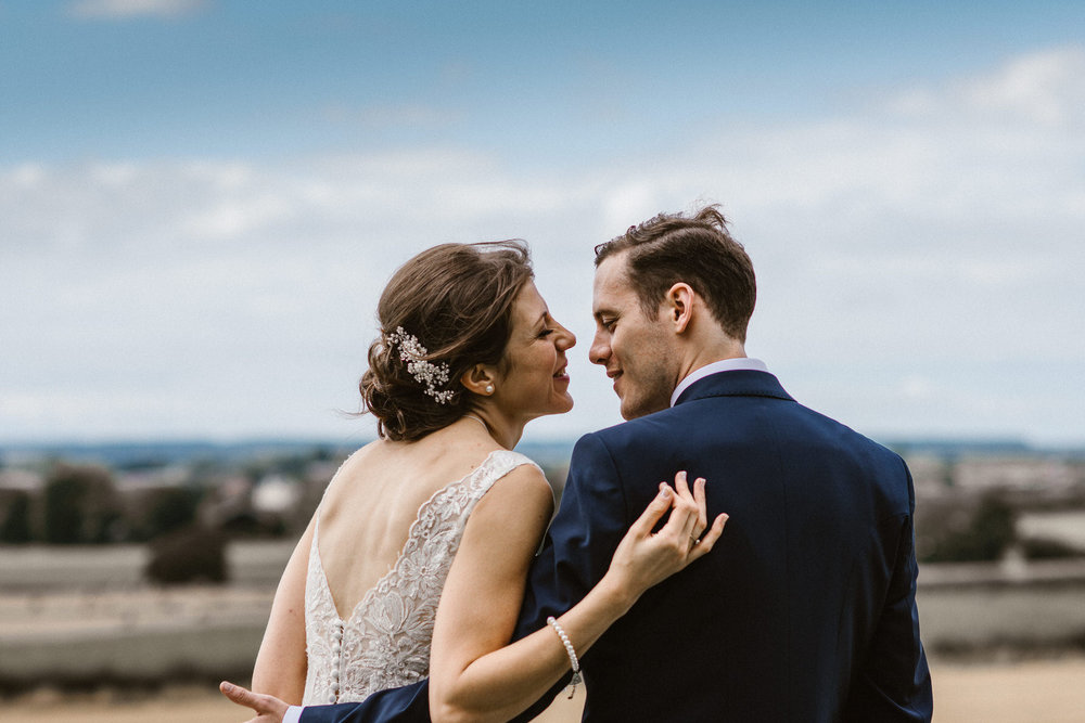 Bride and Groom relaxed couple portraits with field as backdrop