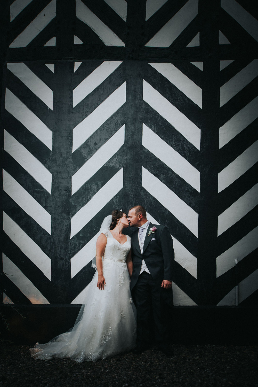 Bride and Groom portrait against black and white background