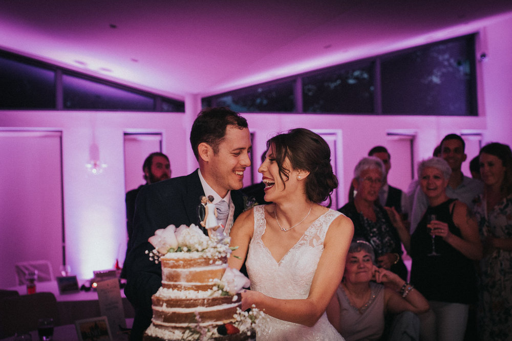 Often venues like to set up a cake cutting before it actually happens (I'm not even really sure why they do this).  I prefer not to, and capture it as it really happens!