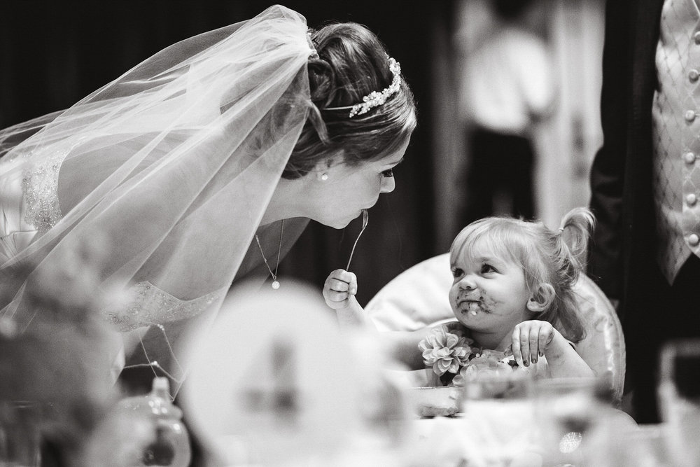 A bride and a child during the wedding reception
