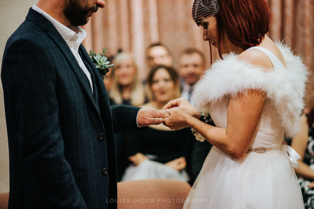 Documentary Wedding Photography - a bride and groom exchanging wedding rings