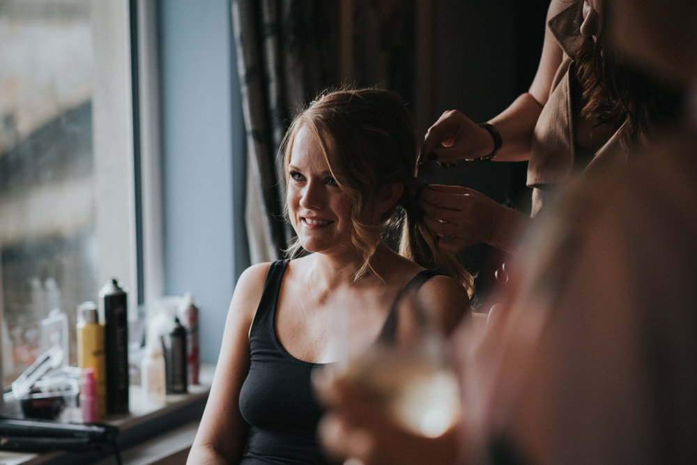 Candid unposed documentary wedding photography image of a bride getting ready