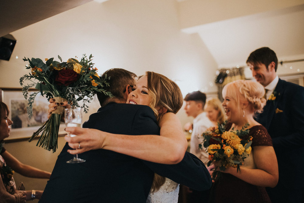 Documentary Wedding Photography bride hugs guest