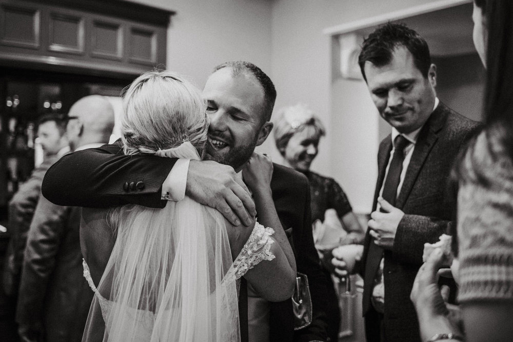 Documentary Wedding Photography hug at Stone House Hotel