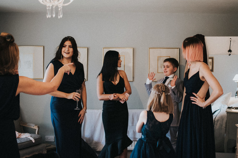 Bridesmaids chatting during bridal preparations